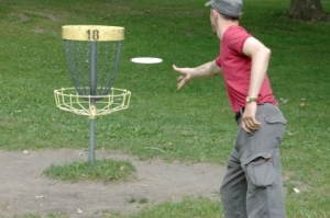 "Disc golf is similar to ""ball golf"" but uses discs to hit a metal chain basket target"